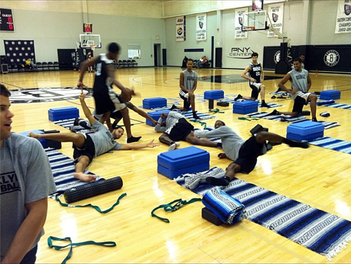 Gerald Wallace of the Brooklyn Nets must have had a hard night because he crashes, falling asleep during a team yoga session