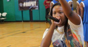 Image courtesy of Danny Digital.  Bria Janelle, the voice of the AEBL gets the crowd hyped for dome basketball action.