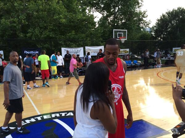 "Image courtesy of Rodney ""Mehka"" King. Kevin Ware chats courtside with a local reporter."