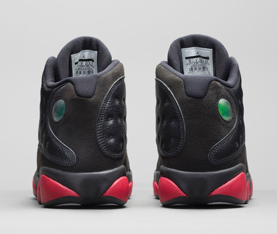 ... Air Jordan 13 Retro brings back a black leather and suede upper with Gym  Red pods. 940x792q80 940x482q80 940x583q80 ...