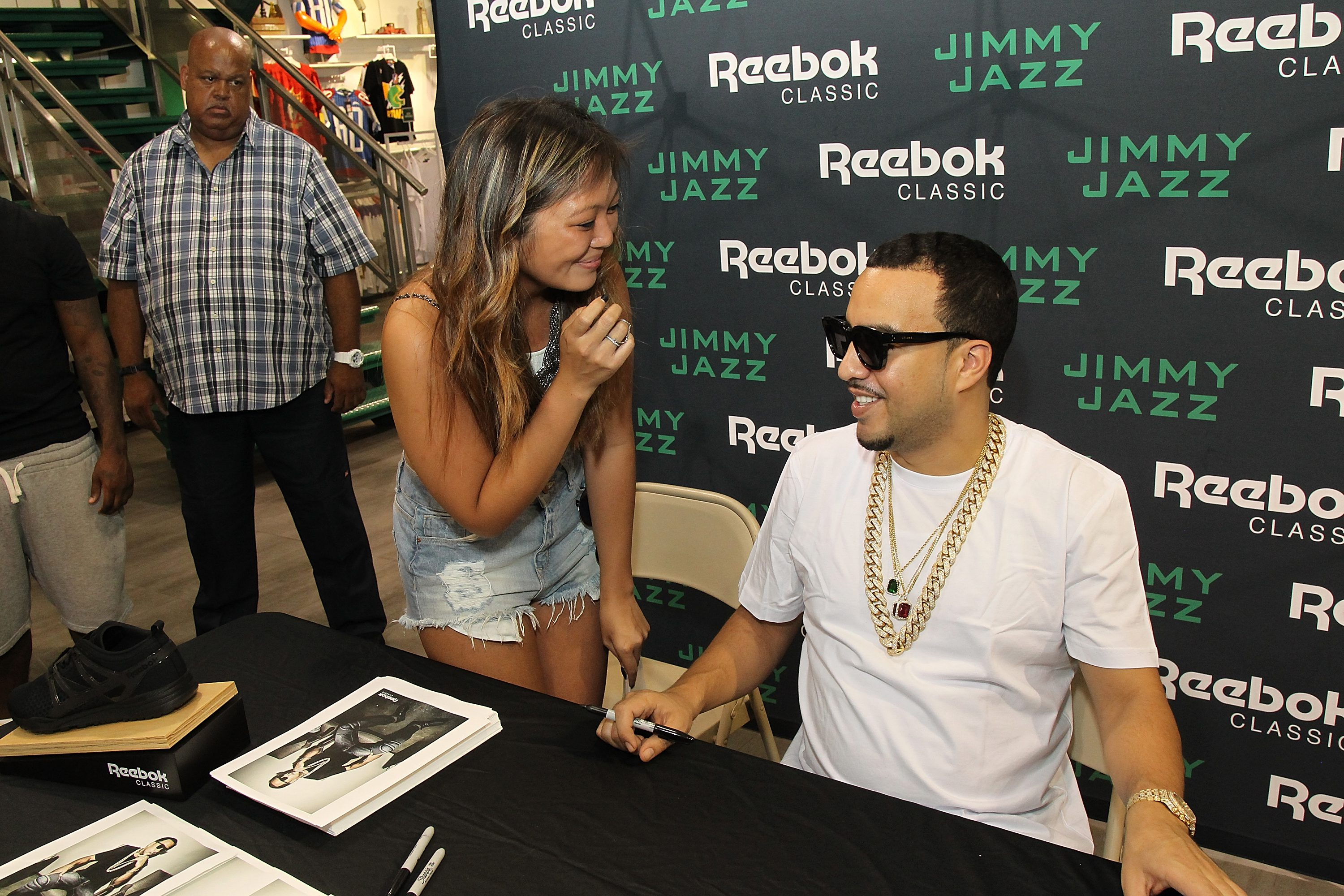 NEW YORK, NY - AUGUST 30:  French Montana poses with a fan during the Launch of the Ventilator ST at Jimmy Jazz in Harlem on August 30, 2015 in New York City.  (Photo by Bennett Raglin/Getty Images for Reebok)