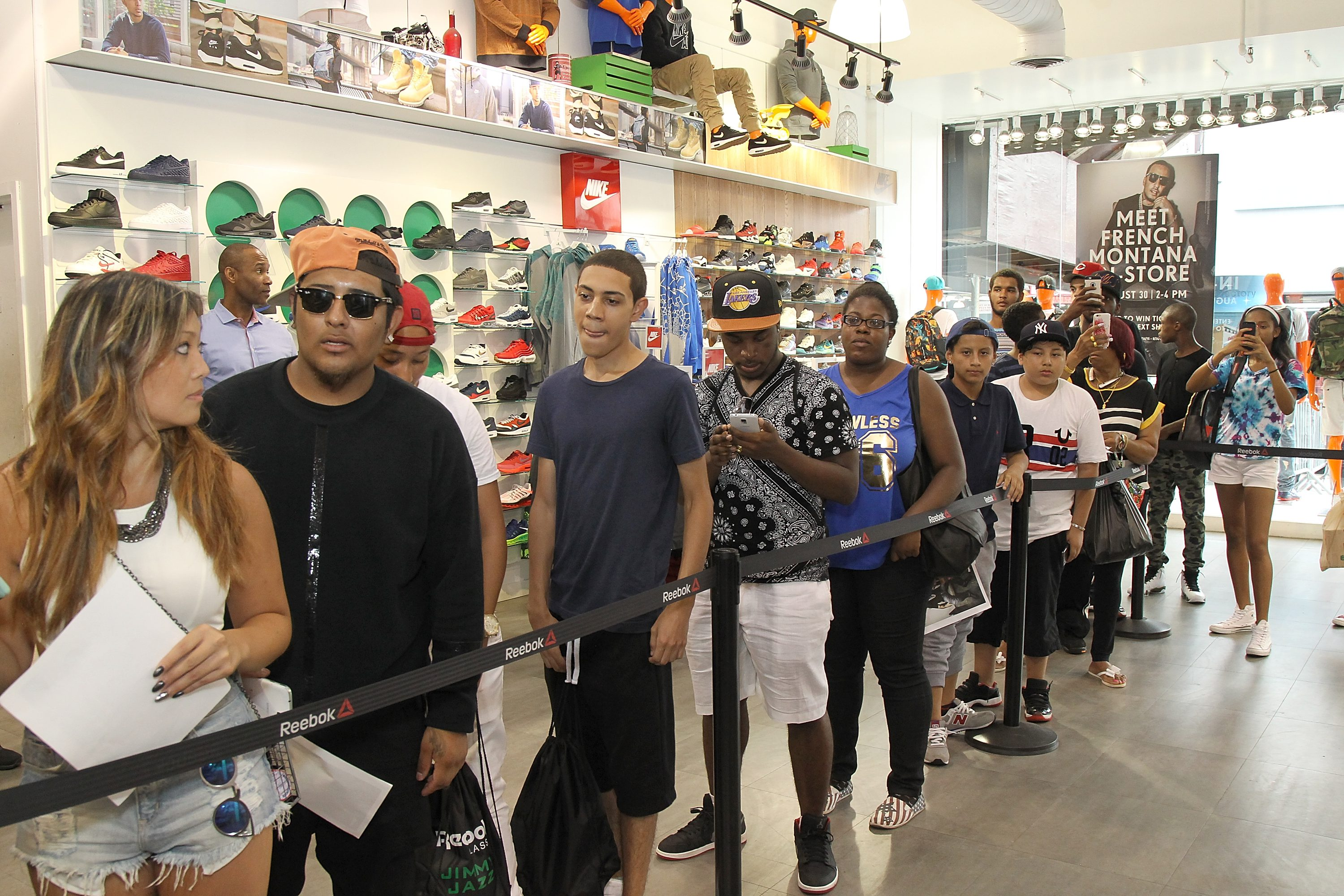 NEW YORK, NY - AUGUST 30:  Fans line up inside the Jimmy Jazz store during   French Montana's launch of the Ventilator ST at Jimmy Jazz in Harlem on August 30, 2015 in New York City.  (Photo by Bennett Raglin/Getty Images for Reebok)