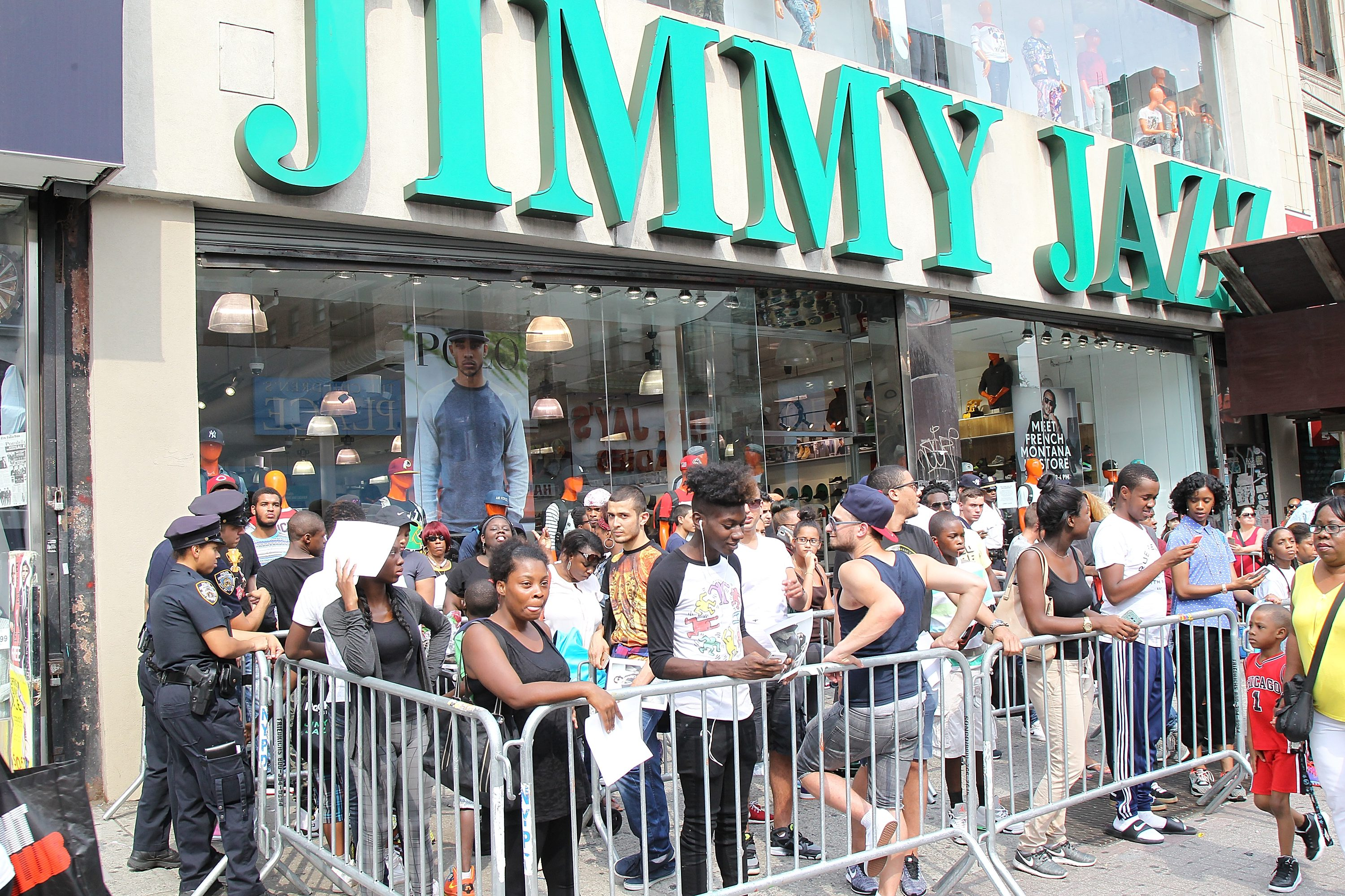 NEW YORK, NY - AUGUST 30:  Fans line up outside the Jimmy Jazz store during   French Montana's launch of the Ventilator ST at Jimmy Jazz in Harlem on August 30, 2015 in New York City.  (Photo by Bennett Raglin/Getty Images for Reebok)