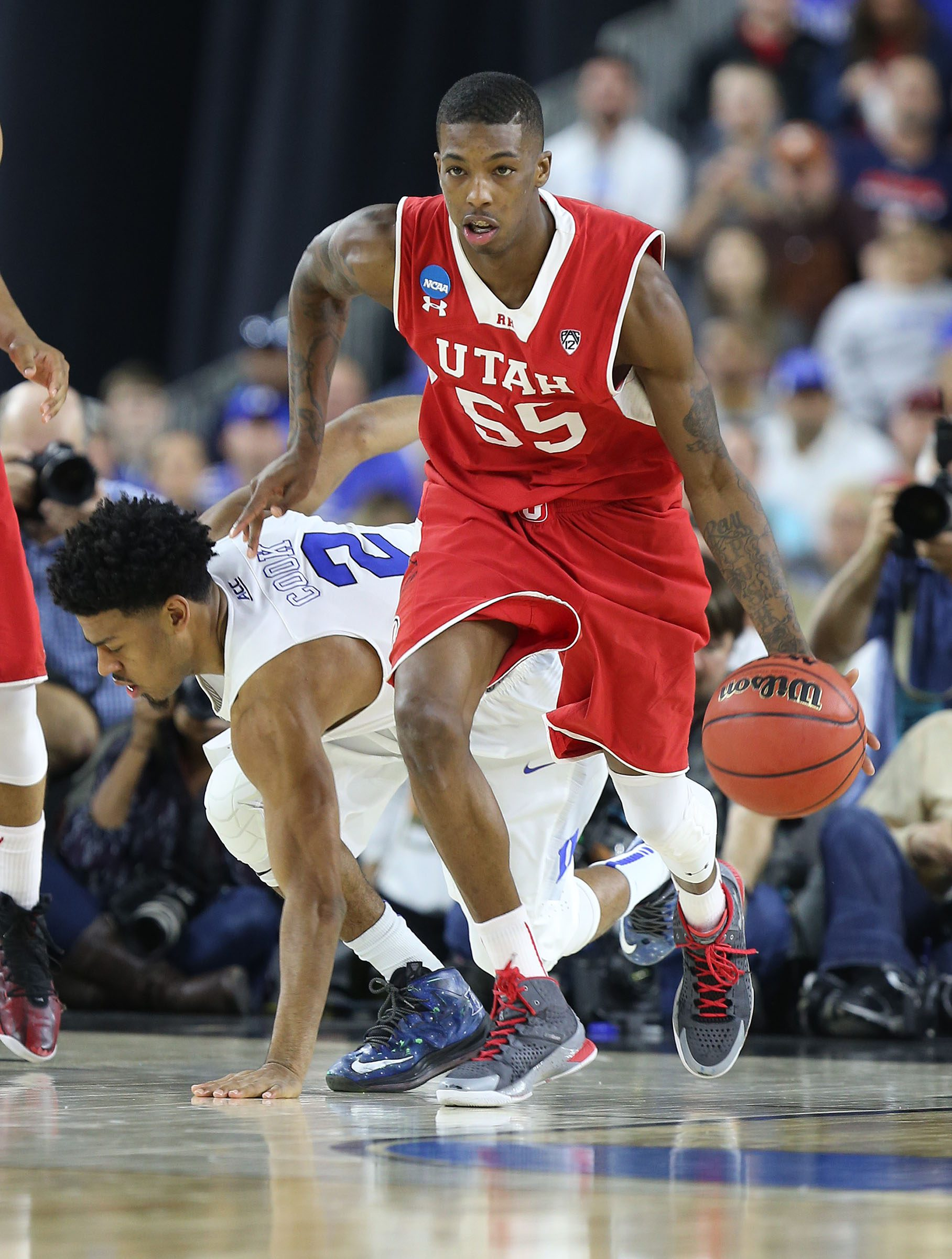 Utah Utes guard Delon Wright (55) as the University of Utah is defeated by Duke 63-57 in the Sweet Sixteen round of the NCAA Men's Basketball Tournament Friday, March 27, 2015, in Houston.